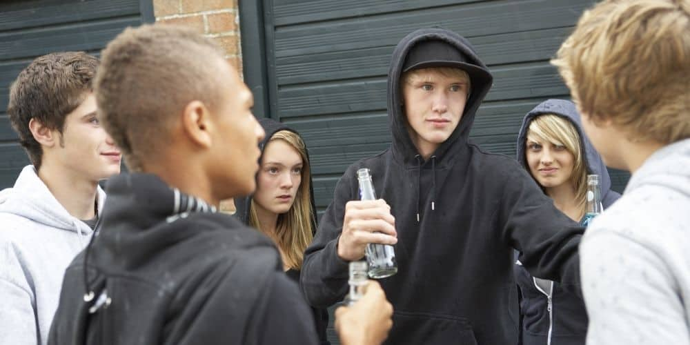 How can I talk to a teenager about drinking? A group of teenagers holding bottles.